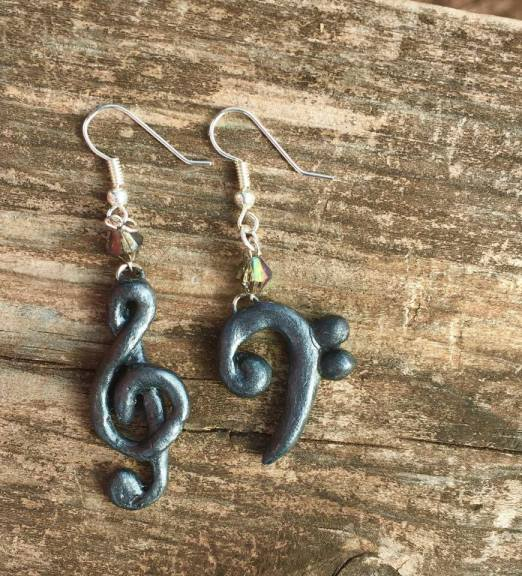 Polymer clay earrings, hand-painted with metallic paint.